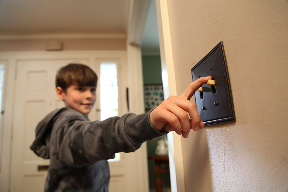 Boy Turning off Light